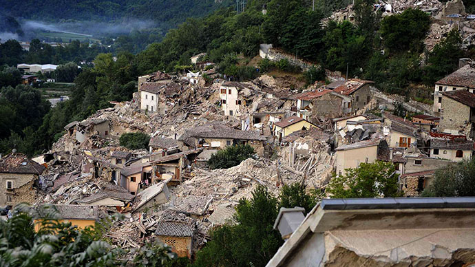 A view of the collapsed buildings of the town of Pescara del Tronto, Italy, after an earthquake, Wednesday, Aug. 24, 2016. The magnitude 6 quake struck at 3:36 a.m. (0136 GMT) and was felt across a broad swath of central Italy, including Rome where residents of the capital felt a long swaying followed by aftershocks. (Cristiano Chiodi/ANSA via AP)
